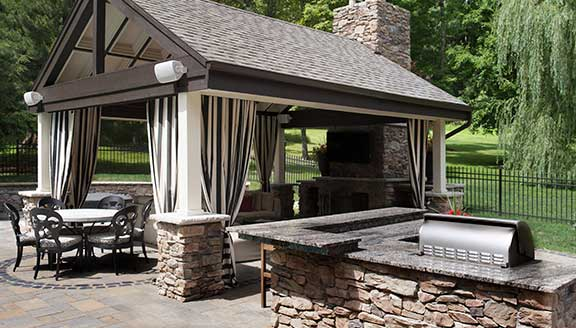 Hardscape design with outdoor kitchen and pergola