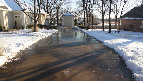 Residential snow and ice removal on driveways sidewalks and walkways