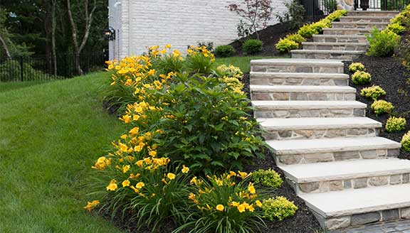 Lawn maintenance stone steps and walkway design