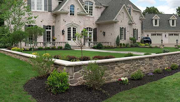 Lawn maintenance and stone retaining wall designs