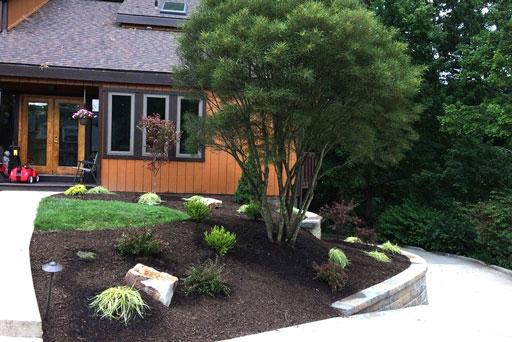 Artistic Tree & Landscape Creations residential landscape service — modern home landscape design