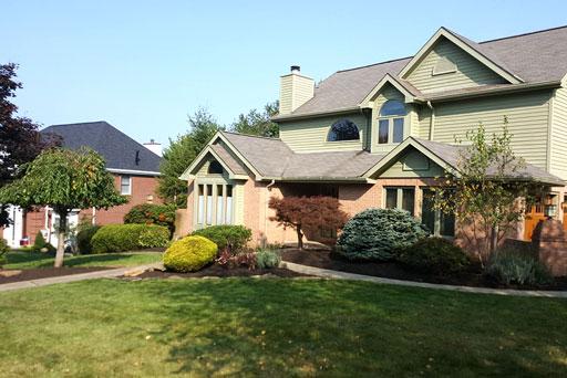 Artistic Tree & Landscape Creations residential landscape service — modern home landscape maintenance